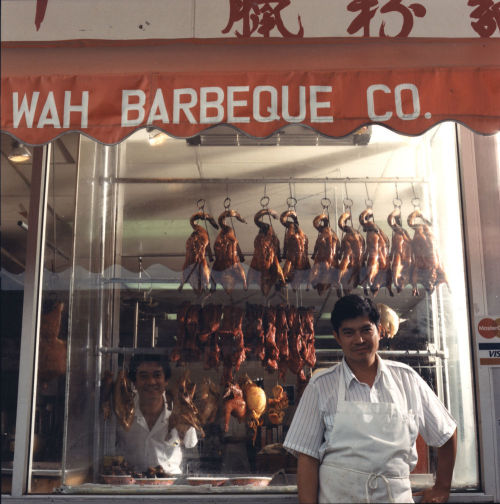 Wah Barbeque Co. with barbequed ducks on display, c. 1987. Photograph by James Newberry. Want a copy of this photo?  > Visit our Rights and Reproductions Department and give them this number: ICHi-36667 Connect with the Museum