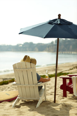 Adirondack chairs on the sand