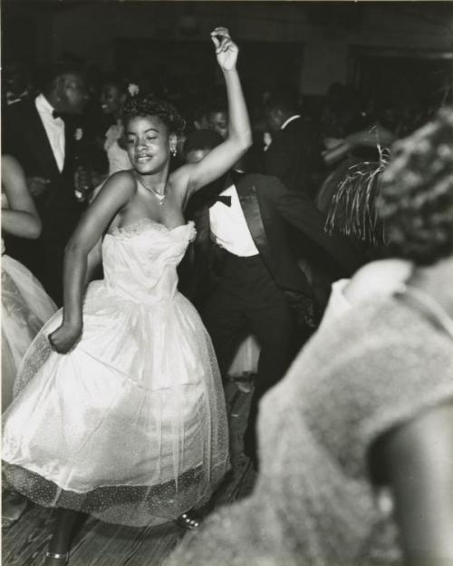 blua:  Dancers at the Bon Temps Carnival Ball, New Orleans, 1953.