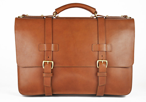 "How to Examine Quality in Leather Goods, Part II We talked last week about how to judge the quality of leather, but there's more to leather goods than leather, of course. There's also the hardware and how everything has been put together. High quality leather will mean little if the brass snaps on your bag break or the lining rips out. So today, we'll review each in turn, and talk about some things you can look for when shopping around.   Hardware Any bag or piece of luggage will be made with a variety of hardware. These can include swivel snap hooks, which are commonly used to attach the leather shoulder strap to the bag; tucks, which are used under a buckled strap so the strap does not need to be buckled and unbuckled; and various latches. Any of these can fail if they're not made well. Frank Clegg, the eponymous owner of Frank Clegg Leatherworks, told me last week that zippers are perhaps the most common point of breakage. ""We had a $600-700 leather coat dropped by our workshop just recently,"" Frank said. ""It had eight different zippers, all of which had the pulls snap off. The zippers had pulls that look similar to the ones we use, but instead of taking a wire loop and casting around it, they cast the loop into the pull. The cast metal just snaps off when it's that thin."" Frank suggests that consumers look for something that's of a good weight. High quality hardware has a thicker look and feel, and the casting seams are usually removed and polished. If the metal has been treated with some kind of finishing, you may also want to examine the quality of the job. Solid brass, for example, can be left natural (which is OK) or polished and then lacquered, and zinc and steel can be plated with brass or nickel. If these lacquering or plating jobs haven't been done well, the metal can look dull or foggy in a short period of time. Construction In addition to the leather and hardware, there's the matter of how everything has been put together. Much of this depends on the type of product at hand. For example, belts will have their own standards. A high-quality belt will have a leather lining (if the design requires one) instead of the cheap paper stuffing that lower-end manufacturers use. You may also want to examine whether the keeper has been squared off (shaped into a rectangle), and whether the details, such as any beveling, have been done well. One thing you can look for on all leather goods is the quality of the stitching. Naturally, these should always look neat and straight. You may also want to see if the edges have been left raw or if they've been turned. Turned-edge leather is made in a way that's similar to how the edge of a piece of garment has been finished – the edges are turned underneath and then stitched. This yields a more attractive and durable edge, but of course, whether it can be done depends on the job at hand. Alex Kabbaz of Kabbaz-Kelly & Sons has a good article on this you can read here. Takeaways Leather products can be expensive, but if you purchase the right ones, they'll last decades and only get better with time. Look for fully tanned, full-grain leathers; smooth, durable hardware; and neat stitching. If applicable, also look for edges that have been turned and sewn, rather than left raw. You should examine for these things on the outside as well as the reverse side, inside, or any other parts that don't normally show. Even if they're not easily visible, a top-quality maker will make sure that all parts of the product are pleasing and well done, and these are signs that you're buying something of quality. (Special thanks to Dave Munson at Saddleback Leather Co. and Frank Clegg at Frank Clegg Leatherworks for their help with this article. Pictured above is one of Frank Clegg's beautiful briefcases)"
