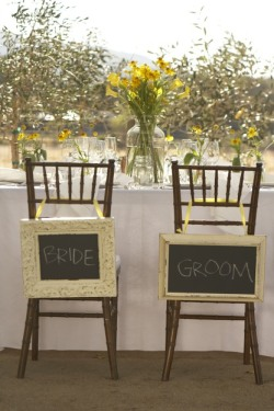 Chalkboards in vintage-style frames make the bride and groom's seats that much more special