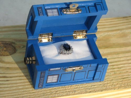 doctorwho:  TARDIS ring box girlofmanycolors:  Not only is this amazing because it is a TARDIS ring box but also the ring is the same kind of engagement ring that Princess Dianna and Kate Middleton wears.  So many of my loves!!!