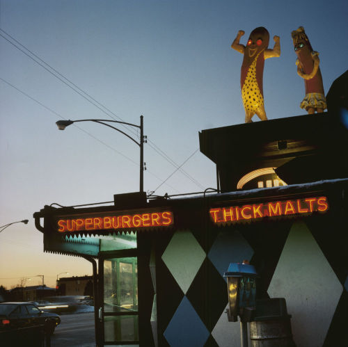 chicagohistorymuseum:  Happy National Hot Dog Day! View of Superdawg, c. 1987. Photograph by Patty Carroll. Want a copy of this photo?  > Visit our Rights and Reproductions Department and give them this number: ICHi-39258