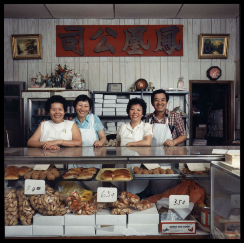 A family at their bakery, c. 1987. Photograph by James Newberry. Want a copy of this photo?  > Visit our Rights and Reproductions Department and give them this number: ICHi-39724 Connect with the Museum