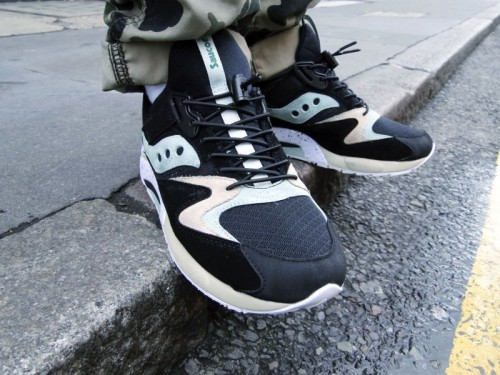 "Sneaker Freaker x Saucony Grid 9000 'Bushwhacker' This year Sneaker Freaker have been celebrating their 10th year anniversary with several collaborations and here is the Saucony one. They've nicknamed their take on the Grid 9000 ""Bushwhacker"" which features include black, mint and beige suede upper with black mesh panels on the toe. They've added their own touch by using spring-loaped lace locks and cord lace which is stretchy. To complete the shoe there is black lining, a speckled mid-sole and the insole even has artwork featuring the Sneaker Freaker 10th anniversary graphic. This is a shoe not to be missed.  In stores from 30th June, including Foot Patrol."