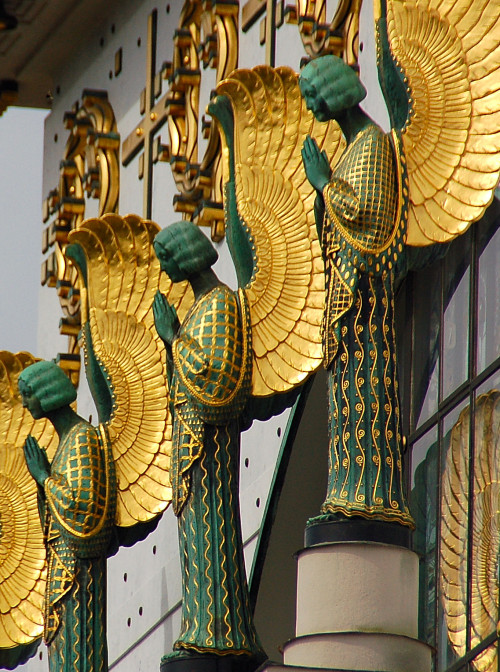Detail of the facade of Kirche am Steinhof, a church on the grounds of a psychiatric hospital (!) in Vienna.  Designed by Otto Wagner, 1907 Photo by kewing