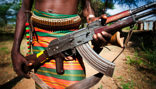 simply-war:  An Ethiopian man holds a kalashnikov rifle at his waist. March 17, 2009. © Michael Hanson