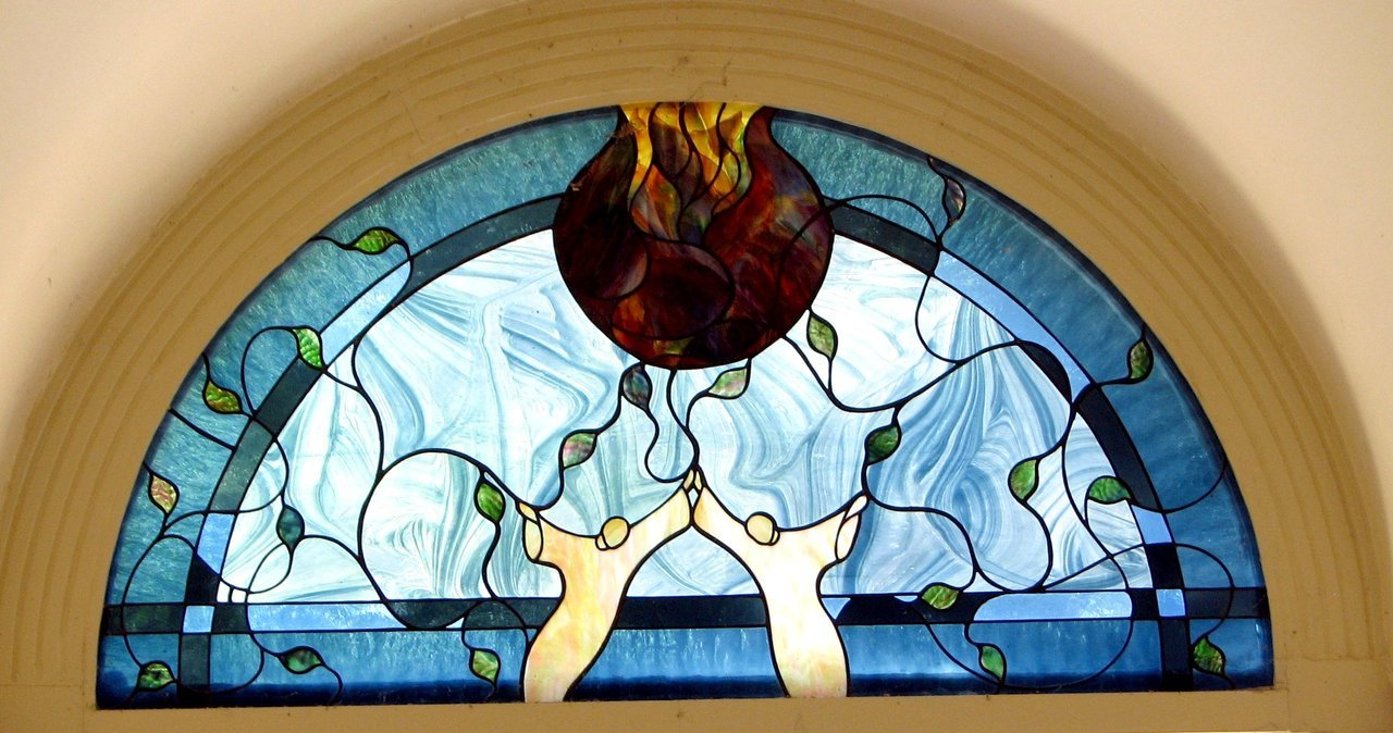 The newer, lighter design of the stained glass window situated above the front door most probably dates back to the 1960's.    Certainly this wouldn't have been put in when the former Carnegie Library building was in use as a police station.