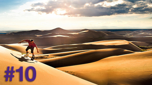 Sandboarding in Great Sand Dunes National Park and Preserve, Colorado -- Glenn Oakley
