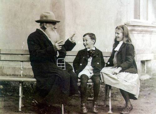 Leo Tolstoy telling fairy tales to grandchildren Sophia and Ilya, 1909.