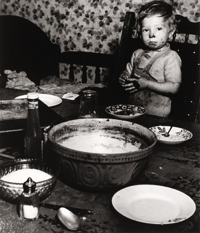 Bill Brandt, London (Little Boy Eating), circa 1937