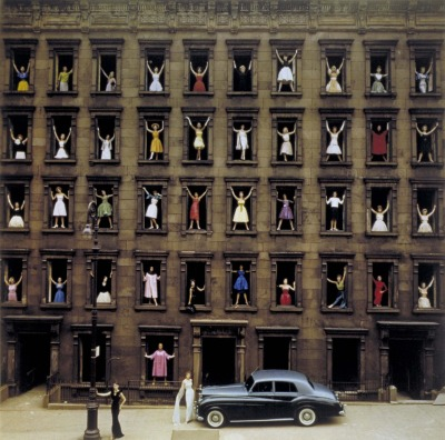 """Girls in the Windows""Ormond Gigli1960color photograph  from Ormond Gigli's official site: In 1960, while a construction crew dismantled a row of brownstones right across from my own brownstone studio on East 58th Street, I was inspired to, somehow immortalize those buildings. I had the vision of 43 women in formal dress adorning the windows of the skeletal facade. We had to work quickly to secure City permissions, arrange for models which included celebrities, the demolition supervisior's wife (third floor, third from left), my own wife (second floor, far right), and also secure the Rolls Royce to be parked on the sidewalk. Careful planning was a necessity as the photography had to be accomplished during the workers' lunch time! The day before the buildings were razed, the 43 women appeared in their finest attire, went into the buildings, climbed the old stairs, and took their places in the windows. I was set up on my fire escape across the streeet, directing the scene, with bullhorn in hand. Of course I was concerned for the Models' safety, as some were daring enough to pose out on the crumbling sills. The photography came off as planned. What had seemed to some as too dangerous or difficult to accomplish, became my fantasy fulfilled, and my most memorable self - assigned photograph. It has been an international award winner ever since. Most professional photographers dream of having one signature picture they are known for. ""GIRLS IN THE WINDOWS "" is mine."
