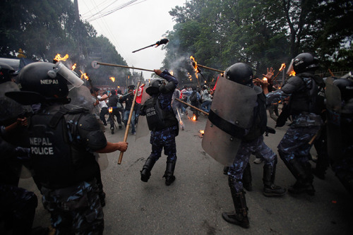 Kathmandu, Nepal: Nepalese police launch a baton charge against students at a torch rally to demand the resignation of the prime minister, Baburam Bhattarai Photograph: Niranjan Shrestha/AP 24 Hours in Pictures 18 june 2012