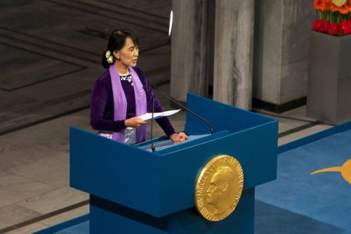 "Aung San Suu Kyi gives Nobel acceptance speech 21 years later LONDON – Twenty-one years after she was awarded the Nobel Peace Prize, Aung San Suu Kyi made her acceptance speech at last on Saturday during her first tour of Europe after spending most of the last two decades under house arrest. ""When I joined the democracy movement in Burma, it never occurred to me that I might ever be the recipient of any prize or honor. The prize we were working for was a free, secure and just society where our people might be able to realize their full potential,"" Suu Kyi said. ""When the Nobel committee chose to honor me, the road I had chosen of my own free will became a less lonely path to follow."" The 66-year-old democracy campaigner was greeted with a standing ovation by the glittering crowd inside Oslo city hall in the Norwegian capital. She spoke clearly and firmly, showing no sign of the exhaustion-induced illness that struck her at an earlier stop in Switzerland. She recalled learning that she had won the 1991 Nobel Prize by hearing news of it on the radio in Burma, also known as Myanmar. With her movements restricted by the country's ruling military junta, she was unable to receive the award in person; her now-late husband accepted it on her behalf. But the recognition helped ease her isolation. ""It had made me real once again. It had drawn me back into the wider human community, and what is more important, the Nobel Prize had drawn the attention of the world to the struggle for democracy and human rights in Burma,"" Suu Kyi said. ""We were not going to be forgotten."" Her belated speech Saturday was made possible because of the Burmese government's recent political liberalization, which has earned praise from around the world. ""There have been changes in a positive direction,"" Suu Kyi said. ""Steps towards democratization have been taken. If I advocate cautious optimism it is not because I do not have faith in the future, but because I do not want to encourage blind faith."" Rather, all sectors of Burmese society must actively participate in and support the reform process, she said. And in the only part of her address to be interrupted with applause, she called for the release of other political prisoners in her country. ""I am standing here because I was once a prisoner of conscience. As you look at me and listen to me, please remember the oft-repeated truth that one prisoner of conscience is one too many,"" she said. ""Those who have not yet been freed, those who have not yet been given access to the benefits of justice in my country number much more than one. Please remember them and do whatever is possible to effect their earliest, unconditional release."" Suu Kyi's tour of Europe will also take her to Ireland and to Britain, where she was once a student at Oxford. In London, she will enjoy the rare honor of addressing the British Parliament. On Saturday, Suu Kyi emphasized the need for universal human rights to be upheld around the world. ""Receiving the Nobel Peace Prize means personally extending my concern for democracy and human rights beyond national borders. The Nobel Peace Prize opened up a door in my heart,"" she said, then urged her audience: ""Let us join hands to try to create a peaceful world where we can sleep in security and wake in happiness."" Pictured: Burmese democracy activist Aung San Suu Kyi delivers her Nobel Peace Prize acceptance speech 21 years after she was accorded the honor. Credit: Ragnar Singsaas / Getty Images"