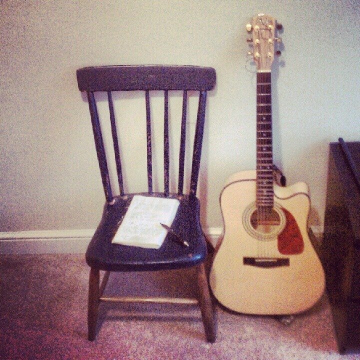 My old blue chair broke yesterday while I was strumming my guitar. I have to fix it because a new seat would stifle my creativity. For me, that blue chair is like Picasso's blue guitar. Most writers have strange habits or superstitions; I only have one: that chair is where I am meant to sit when I write. I don't mean where I want to sit, but where I should sit. During school, I wrote nearly every paper in that chair while leaning back as far as I could without tipping over. When I play guitar and am seriously creating, I feel the process flow most purely while in that chair. Before I went to college, I randomly snagged it from a pile of my parents' antiques. I didn't know the love that would develop. I'd be lying if I called it comfortable, but I like that it keeps me awake with its hard, wooden presence. — K.C.