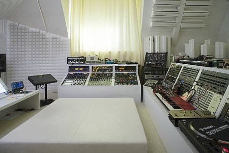 bitbin:  Nice and today electronic music studio. Does not have to be dark and moody. Who's is it?  It's like the controls of a space from the 70's