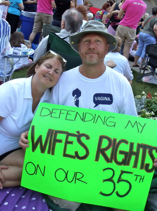 restless-chelle:  togetherwecanbehappy:  This is from the rally at the Michigan State Capitol building today when Eve Ensler brought her award winning play, The Vagina Monologues, to the steps of the capitol.  Over 5,000 people attended; how AWESOME are these two celebrating their anniversary in one of the coolest ways ever?! (PS I know it's lame, but these are my parents and they are seriously awesome… obviously.)  this made me a little teary honestly.