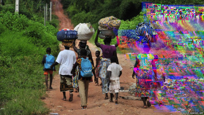 glitchnews:  Displaced villagers seeking refuge walk on a road leading to the western village of Tai in the Ivory Coast. Seven UN peace keepers, ten civilians and one Ivorian soldier were killed in sporadic violence in south west Ivory Coast near the border with Liberia.