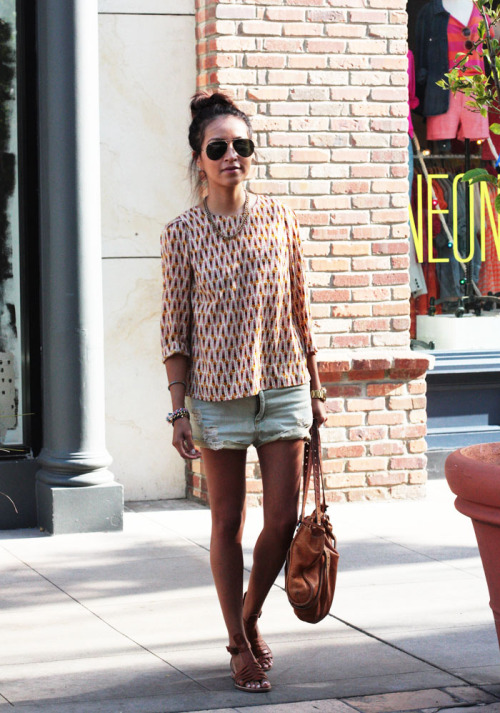 what-do-i-wear:  Blouse: H&M  | Shorts: Quiksilver  |  Bag: Miu Miu  |  Sandals: DKNY  | Necklace + Bracelets: Alimonada  |  Shades: Ray Bans (image: sincerelyjules)