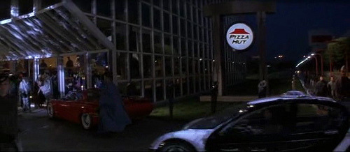 Taco Bell/Pizza Hut in Demolition Man How would you feel if there would be only one restaurant in the future? Well, in the movie Demolition Man (1993), which was set in 2032, Taco Bell is the only restaurant left in existence. In the movie, it is presented as a fine dining establishment, complete with valet parking and a dance floor. However, PepsiCo, Taco Bell's and Pizza Hut's parent company, decided that some movie scenes will be filmed twice. Taco Bell, which wasn't widely known outside the US, was replaced with Pizza Hut. This included dubbing and changing the logos during post-production. Today, you can find two different versions of the film in circulation (or online).