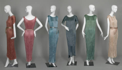 Currently obsessed with the brilliance of Fortuny.  tweed-eyes:  Delphos dress, 1948. Pleated silk. Mariano Fortuny, Italy.  The Chicago History Museum  Mariano Fortuny is best known as the creator of the Delphos dress, styled after classical Grecian dress. Although first created in 1907, Fortuny continued making the Delphos until his death in 1949. Many of the garments here were purchased and worn by Chicago women decades after they were originally made; some even cut inches off the hems to update the style.