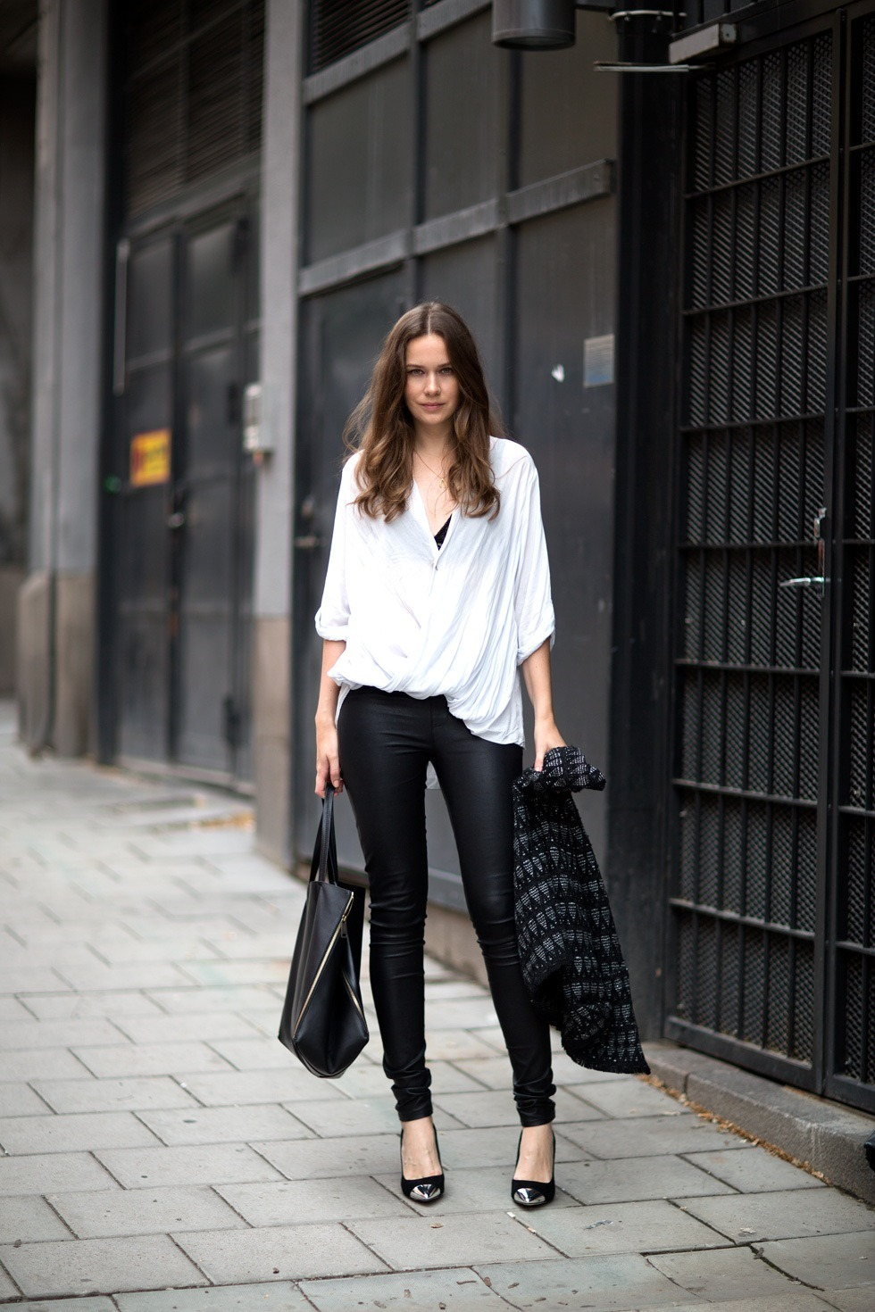 the-mode-de-vie:  Caroline (Via Carolines Mode) Absolutely love this look by the amazing owner and founder of one of my favourite Street Style/Fashion blogs. She wears pants and top from Helmut Lang, jacket from IRO, bag from Celine and heels from Topshop. I love the simplicity of this look but how it is so on trend and edgy all at the same time! The leather pants add a tough element almost an motorcycle ambiance to the look where is the casual relaxed fit of the style adds a feminine touch and with the hint of a black lace bra showing it complements the top! The gorgeous Celine bag is a statement and the focal point of this ensemble, a jacket from IRO enhances the look and also puts a hint of elegance in this entire look. A pair of heels from Topshop with a metallic point, tie in the jacket and silver detailing on the bag!  Perfection!