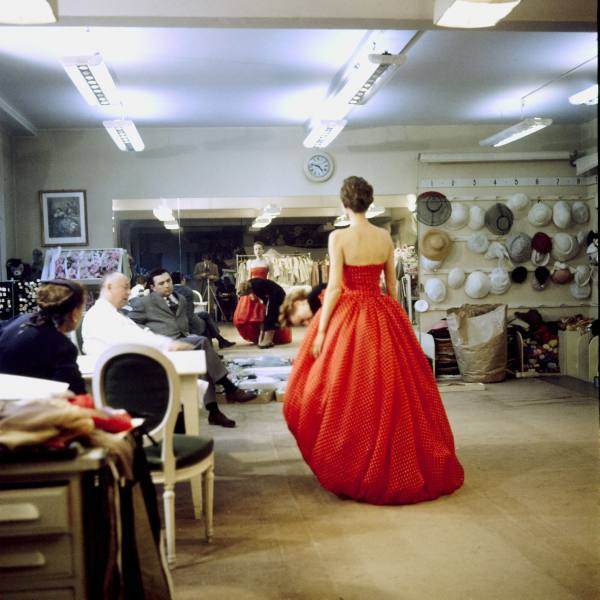 theniftyfifties:  Christian Dior (in white) commenting on a red gown for his new collection prior to showing. Paris 1957. Photo by Loomis Dean.