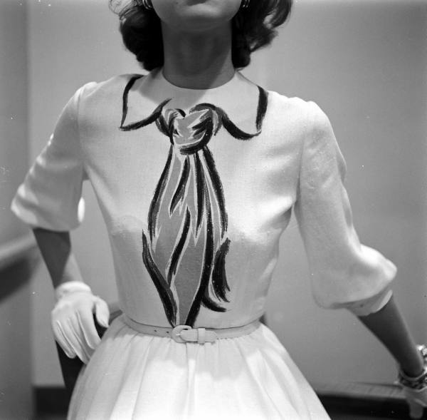 theniftyfifties:  Model wearing a Hermes ensemble with a drawn on tie, 1952. Photo by Gordon Parks.