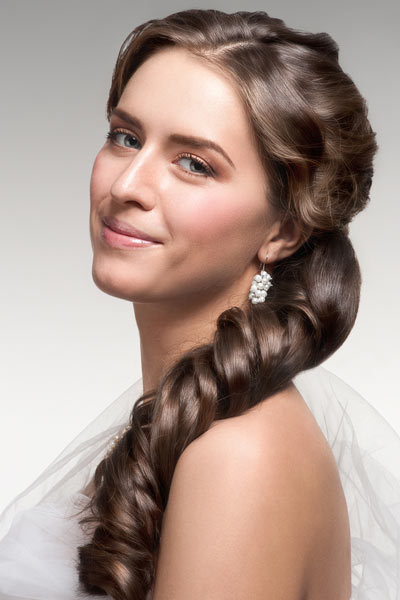 Curly Side Ponytails: Without Heat! Add extra fun and sex appeal to your ponytail hairstyle! Wearing the classic updo to the side with lots of curl takes the look from everyday to evening. These curled ringlets worn high or low are perfect for special events from prom to weddings.