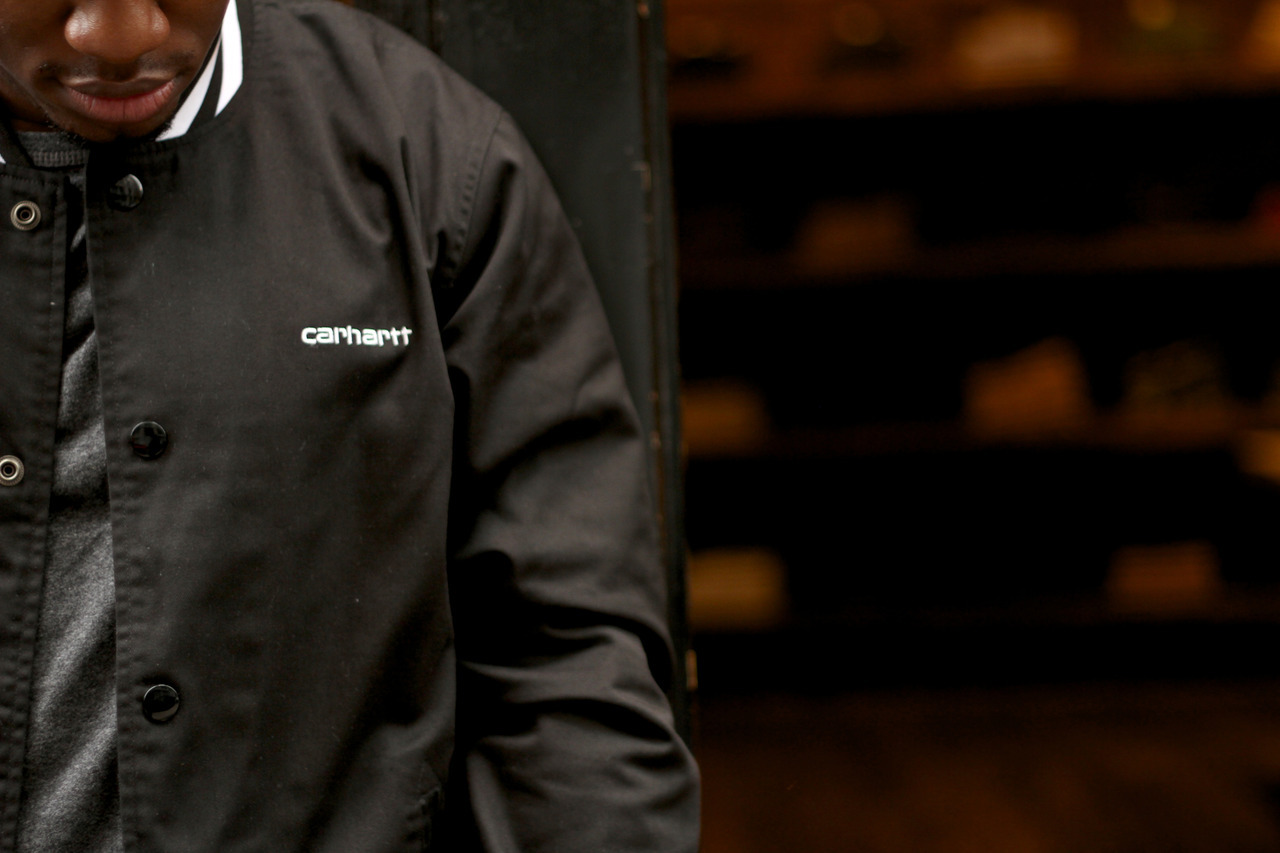"A closer look at Carl Williams' Carhartt jacket in front of Carhartt Work in Progress on Crosby Street. ""The quality of the product and the minimal branding to me personally is great. Keeps it simple."" Photography: Donnell Culver"