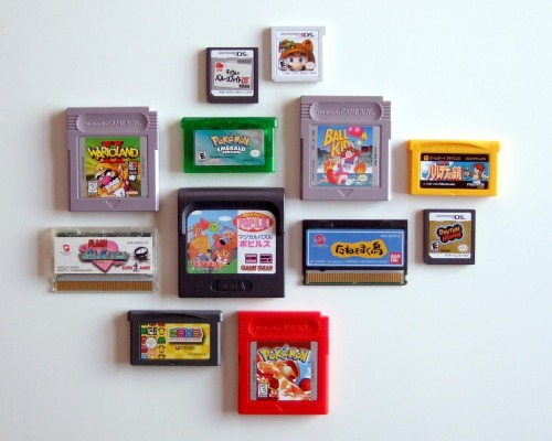 "tinycartridge:  It's a tiny cartridge reunion! Not everyone could make it, but almost everyone from the Nintendo side of the family is here — Game Boy, GBA, DS, and 3DS. There's Sega's Game Gear sandwiched between, wait, who are those guys? Oh, a couple relatives from overseas, Gunpei Yokoi's kids, WonderSwan and WS Color, showed up! Just a reminder that portable games are the best. Buy: Tiny Cartridge stickers for your DS/3DS cartridges See also: ""Collection"" by Terry Mack [Via The Gay Gamer]"