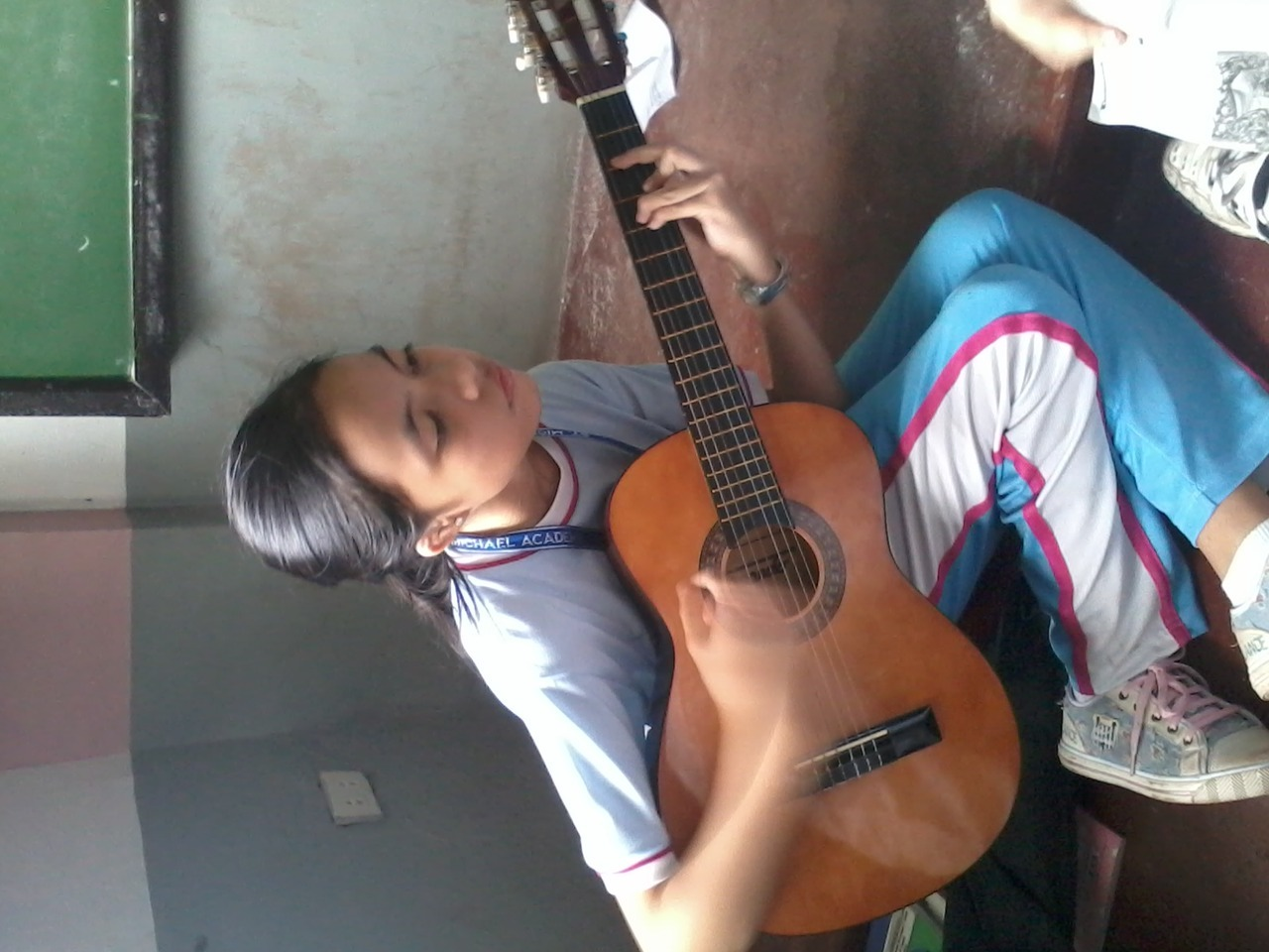 A pic of me at school playing my guitar… I think the song that I was playing was It Will Rain by Bruno Mars…