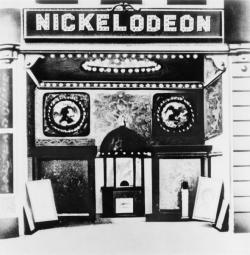 "thepittsburghhistoryjournal:  Entrance to the Harris nickelodeon, Smithfield Street in Pittsburgh, 1919. Carnegie Library of Pittsburgh (via)  On This Day in Pittsburgh History: June 19, 1905  The ""Nickelodeon,"" the country's first all-motion picture house, was opened by Harry Davis and John P. Harris at 433-35 Smithfield Street with the showing of two short films, ""Poor but Honest"" and ""The Baffled Burglar."" It was a great success, with people flocking to the place and marveling at the moving figures. [Historic Pittsburgh]  Related: ""You Saw It Here First: Pittsburgh's Nickelodeon introduced the moving picture theater to the masses in 1905,"" by Timothy McNulty for the Pittsburgh Post-Gazette, 2005."
