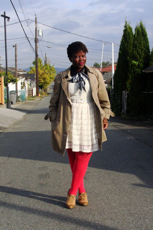 Lydia of Style is Style in a classic trench and bow-tied scarf.