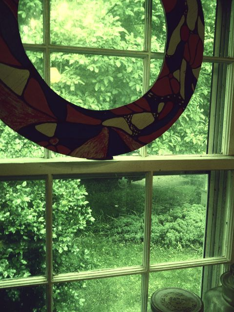 Outside my kitchen window. Wood Wreath circa 1970 <3