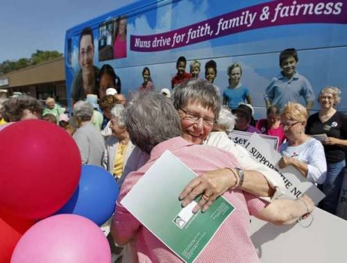 think-progress:  Roman Catholic nuns are on a 9-state bus tour to protest the House Republican budget, which cuts federal dollars to food pantries, shelters, schools, and hospitals.  Photo Credit: Des Moines Register.