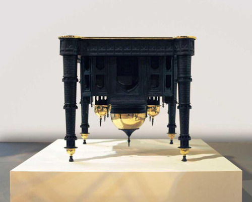 modernizing:  Taj Mahal table by Studio Job Studio Job created this controversial table based on the Taj Mahal for the Carpenters Workshop Gallery. As a commenter on gizmodo notes:  This has got to be the ugliest table I've ever seen. Being an Indian, I know that The Taj Mahal holds a lot of value to the people here. Aside from being a marvelous work of architecture, it is also a symbol of love. Turning such a structure upside down and painting it black really disgraces the monument and offends a lot of people…The only thing good about this is the novel idea of using the same architectural concepts of a monument to design a table, but you should also consider the feelings associated with said monument before showing it to the public.   Is there anything wrong with that commenter's argument? None couldn't be found by me!