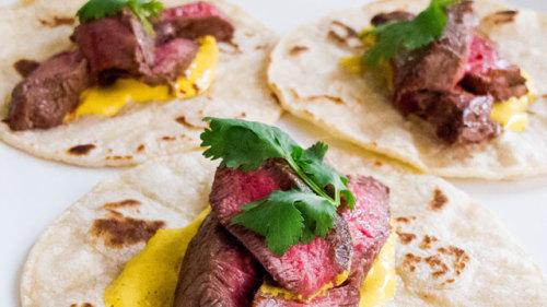 Who knew you could wrap up so much flavor in a corn tortilla?   Cumin-Rubbed Steak Tacos with Turmeric-Lime Crema | Mexican Recipes | PBS Food