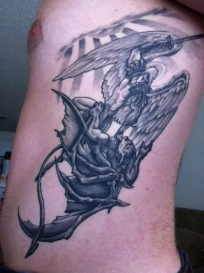 St. Michael on my ribs.  Done by Greg Ashcraft at Skinworx Tattoo in Pelham, Alabama