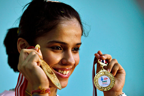 waveofeuph0ria:  Badminton player Saina Nehwal displays the medals she won at the Indonesia Open and the Thailand Open tournaments, during a press conference in Hyderabad, Andhra Pradesh. Ms. Nehwal won the Indonesia Open on June 17, a week after her win at the Thailand Open. Source