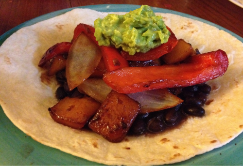 Vegan Mango Teriyaki Fajitas  Ingredients: Small flour tortillas Can of black beans 1/2 white onion 1 red bell pepper About 1/2 cup frozen mango (I got mine from TJ's), or fresh mango Teriyaki Sauce Avocado Garlic, salt, pepper and lemon juice  Directions: Slice bell pepper and onion and sautee in a pan with teriyaki sauce and a little oil After a few minutes, add frozen mango to the pan and stir until mango is warm and veggies are cooked but still crispy. Add teriyaki sauce, salt, pepper and garlic to taste.  Meanwhile, mash avocado with garlic, salt, pepper and lemon juice, or slice plain avocado Heat up black beans and warm the tortilla Pile beans, veggies, and guacamole onto the tortilla Enjoy :)