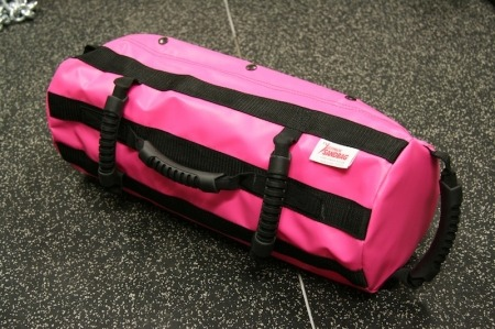Yay! New toy! On its way! In Pink!  Just ordered my pink sandbag and I'm crazy excited. Been using a makeshift sandbag forever (pretty cleverly, I must add), but it's been frustrating to compensate for its…ummm… lack of craftsmanship. It IS an awesome tool, and I love using it, but I'm kinda DONE with cleaning up sand, replacing handles, carefully placing it down and swinging it away from anything breakable, in the event it'll suddenly fly through the air, like a 30lb cannonball. And there's only so much duct taping this girl can handle. Sad little bag, lol.  Aside from its damaged appearance, it's also not nearly as versatile as a real bag, but I modified and survived. At this point though, I'd like something a little sturdier. It takes a lot for me to justify spending so much on equipment unless I REALLY see the value. And I'm satisfied with this choice. See the bag deets here: Ultimate Sandbag Training Systems: Pink Power Package You DON'T need fancy equipment. But sometimes it's nice. :) I've read all the reviews, done my research, and by far this seems to be the winner (also looked at a cheaper model, and the reviews were mixed. Hard to tell if it was a quality issue vs. misuse, but this model seemed favorable by the majority of people. That… and the others didn't come in pink (I'm a sucker for new equipment in general. But offer it in pink and I'm YOURS). I started with a DIY bag and after realizing how much I would use it, decided to level up.  How To Make Your Own Sandbag Been DYING to get my hands on this one for YEARS (inspired by BodyRockTv videos). Debated getting the water filler one, but this won out! Also comes in camo, black and different sizes: this one goes up to 30lbs. Yay! Can't wait for it to come in! Fingers crossed it doesn't take as long as my TRX. I want it NOW. :)Anyone have this one or a similar one? How do you like it?