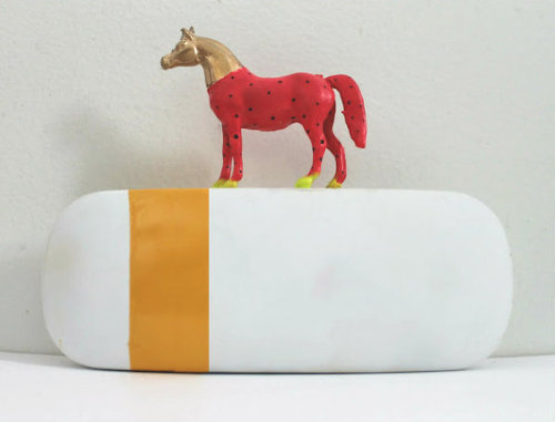 DIY Plastic Animal Minaudiere or Clutch Tutorial by Radical Possibility here. *See similar tutorials here. Also, how much do I love painted plastic toys? See here.