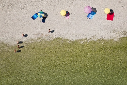 BERNHARD LANG What incredibly well composed aerial photos by German artist Bernhard Lang. It's so hot here in Wisconsin! The juxtaposition of these beautiful beach and snowy winter scenes seem like the perfect combination of refreshing right now.