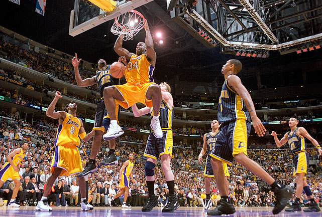 On this day in 2000, Shaquille O'Neal and Kobe Bryant led the Lakers to their first of three consecutive championships with a 116-111 victory over Indiana in Game 6 of the NBA Finals. O'Neal would win MVP honors after averaging 38 points, 17 rebounds and three blocks during the series. (John Biever/SI) GALLERY: Rare Photos of Shaquille O'Neal | Kobe Bryant