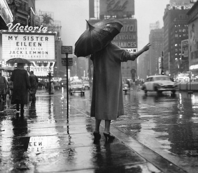 theniftyfifties:  New York City rainy street scene, 1955.