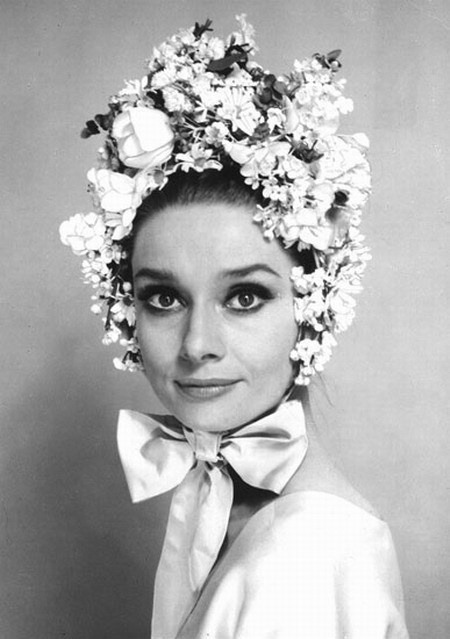 Audrey Hepburn looking like a summer present in an over-the-top topper!