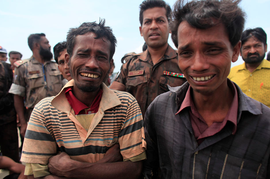 Rohingyas from Myanmar cry after being arrested by Border Guards of Bangladesh (BGB) while trying to get into Bangladesh, in Teknaf June 18, 2012. An unknown number of people fleeing sectarian violence in Myanmar's Rakhine region are adrift in boats on the Naf River and some have been turned back by Bangladeshi border authorities, according to the United Nations refugee agency. REUTERS/Andrew Biraj