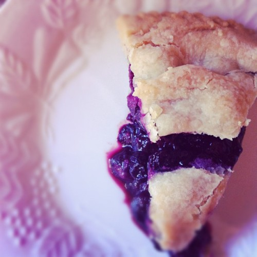 Vegan blueberry pie, yo. Keebler's has a vegan crust, as does Whole Foods.  Ingredients:  2 pints fresh blueberries 1/2 teaspoon lemon zest 1 Tbsp lemon juice 1/4 cup flour (for thickening) 3/4 cup white granulated sugar 1/4 teaspoon cinnamon 2 Tbsp margarine, cut into small pieces Directions:  Heat oven to 425°F.  Mix the blueberries, sugar, flour, cinnamon, lemon zest, and lemon juice in a large bowl. Put in bottom pie crust. Dot with margarine pieces (I forgot to do this on Sunday).  Place second crust on top and press together. I brush the top with a little soy milk before baking. Score the pie on the top with 4 cuts (so steam can escape while cooking).  Place the pie on the middle rack of the oven on top of tin foil to catch spills.  Bake for 20 minutes at 425°.  Reduce heat to 350°F and bake for 30 to 40 minutes more or until juices are bubbling and have thickened.  (After about 10 minutes at 350 I brush the crust with margarine.) Transfer to a wire rack to cool.