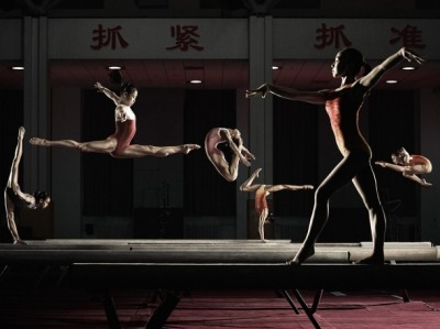 chinesegymnastics:   Picture Perfect This image was taken at the Chinese National Gymnastics Training Centre in Beijing back in November 2009, after training had finished for the day. Some of the gymnasts featured will be competing in the upcoming London Olympics. What makes it stand out is that it was captured all in one take.  I first gave the girls a picture of the poses I wanted and each girl chose one. Next, I got them framed up and then set up the camera. It only took about ten minutes and three takes and we were done. The girls were so accurate in terms of their timing when performing their moves, that the process of coordinating everyone and ensuring no one overlapped was amazingly straight-forward.  — Adam Pretty  (Pictured from left to right: Tan Sixin, Sui Lu, Wu Liufang, Chen Shihua, Huang Qiushuang and Huang Huidan.  Photo Credit: Adam Pretty)
